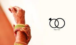 Wedding invitation card, Indian bride wedding style bride putting bangles & bracelet Jewelry royalty free stock image