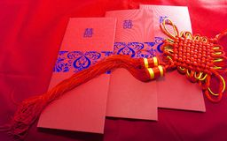 Wedding invitation card and lucky knot Royalty Free Stock Image
