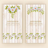 Wedding invitation card. Vector invitation card with elegant flower elements with text on wood background. Royalty Free Stock Image