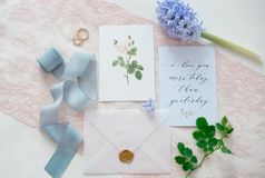 Wedding invitation card. As a decorated letter with flowers and ribbons top view royalty free stock photos