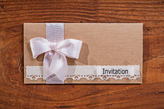 Wedding invitation envelope on old wooden board Stock Photography