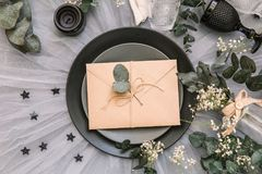 Wedding  invitation envelope. reception table setting with rustic shabby chic decorations. Flat lay, top view, copy space Stock Image