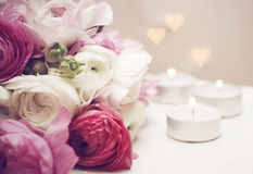 Wedding invitation. Flowers with candles and romantic light stock images