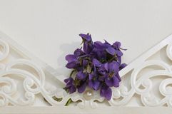 Wedding invitation with flowers. Macro detail of wedding invitation with Viola flower Royalty Free Stock Images