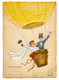 Wedding invitation. Funny bride and groom on air balloon Royalty Free Stock Image