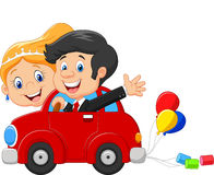 Wedding invitation with funny bride and groom on car driving to their honeymoon Royalty Free Stock Photography