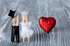 Wedding invitation. Man, woman and read heart. Groom in black suit and bride in white dress. Clot Stock Images
