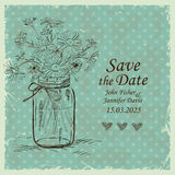 Wedding invitation with mason jar and camomile flowers Stock Photos