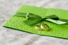 Wedding invitation and rings Stock Photography