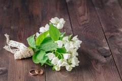 Wedding invitation. small bouquet of white flowers Stock Images