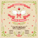Wedding invitation with swans couple and floral frame Stock Photo