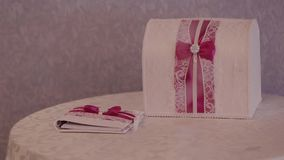 Wedding invitations and money chest decorated with lace.  stock video footage