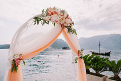 Wedding isle and arch. With weddings chairs and wedding flower decoration Stock Image