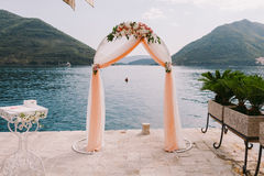 Wedding isle and arch. With weddings chairs and wedding flower decoration Royalty Free Stock Images