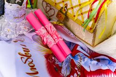 Wedding items, composition of festive paraphernalia for the wedding. Colorful scenery in nature, photo for memory. Represents tenderness and romance of the stock photo