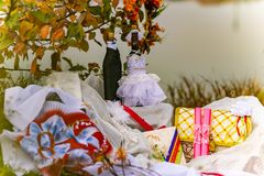 Wedding items, composition of festive paraphernalia for the wedding. Colorful scenery in nature, photo for memory. Represents tenderness and romance of the royalty free stock image