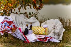 Wedding items, composition of festive paraphernalia for the wedding. Colorful scenery in nature, photo for memory. Represents tenderness and romance of the stock photography