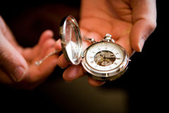 Wedding Jewelry. A woman holding a classic pocket watch Stock Photos