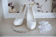 Wedding jewelry. Accessories of the bride. Shoes, bracelet Stock Photos
