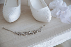 Wedding jewelry. Accessories of the bride. Shoes, bracelet Royalty Free Stock Images