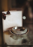 Wedding jewelry. On a table Royalty Free Stock Photos
