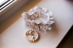 Wedding jewelry, white garter bride, white earrings Stock Photography