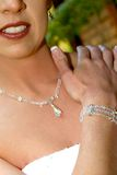 Wedding Jewels. A bride wearing a necklace, an arm bracelet and earrings stock photo