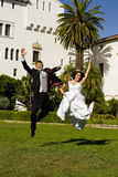 Wedding jump. Bride and groom jumping in the air Royalty Free Stock Photography