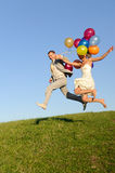 Wedding jumping. Flight of young and happy wedding pair. good use for loving concept Royalty Free Stock Image
