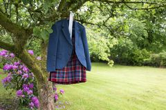 Wedding Kilt Hanging on wooden frame Royalty Free Stock Photos