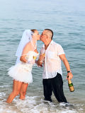 Wedding kiss. On the tropical beach Stock Image