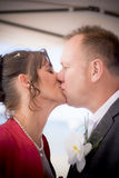 Wedding Kiss. Just Married Bride And Groom Embrace In A Wedding Kiss Just After A Beach Marriage Ceremony Stock Images
