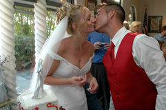 Wedding kiss. A happy newlywed couple kissing at reception Stock Photography