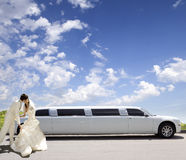 Wedding kiss. Happy bride and groom about limousine in wedding day Royalty Free Stock Photography