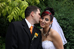 Wedding Kiss. Groom and bride in the kiss Royalty Free Stock Photography