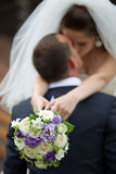 Wedding kiss. A bride and groom kissing Royalty Free Stock Image