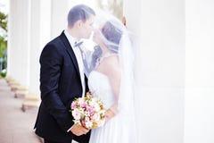 Wedding kiss. Couple kissing in wedding day Stock Image