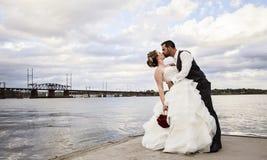 Wedding kiss on dock royalty free stock photo