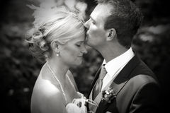 Wedding kiss on forehead Stock Photo