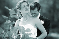 Wedding kiss on her neck. Young groom is kissing the neck of his bride after the wedding ceremony.  that was a very romantic and tender wedding kiss Stock Photo