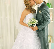 Wedding kiss just married couple. Wedding kiss as husband and wife shot at the studio Royalty Free Stock Photos