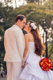 Wedding kiss. Multi-ethnic wedding couple kissing in the park Royalty Free Stock Image