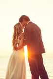 Wedding kiss outdoor in daylight Royalty Free Stock Photo