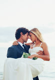 Wedding kiss outdoor in daylight stock images