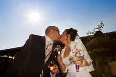 Wedding kiss with sparkling glass stock image