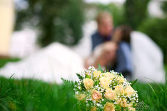 Wedding kiss, wedding bouquet, summer Stock Photography