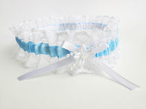 Wedding lace garter. Blue wedding lace garter with white ribbon Royalty Free Stock Photos