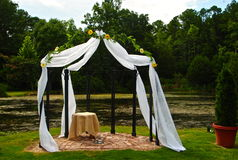 Wedding at the Lake. Wedding Arbor with Tule an Flowers Royalty Free Stock Photo