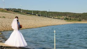 Wedding On A Lake. Bride and groom on a lake stock footage
