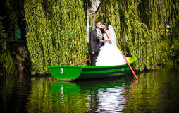 Wedding on lake in willows Stock Photos